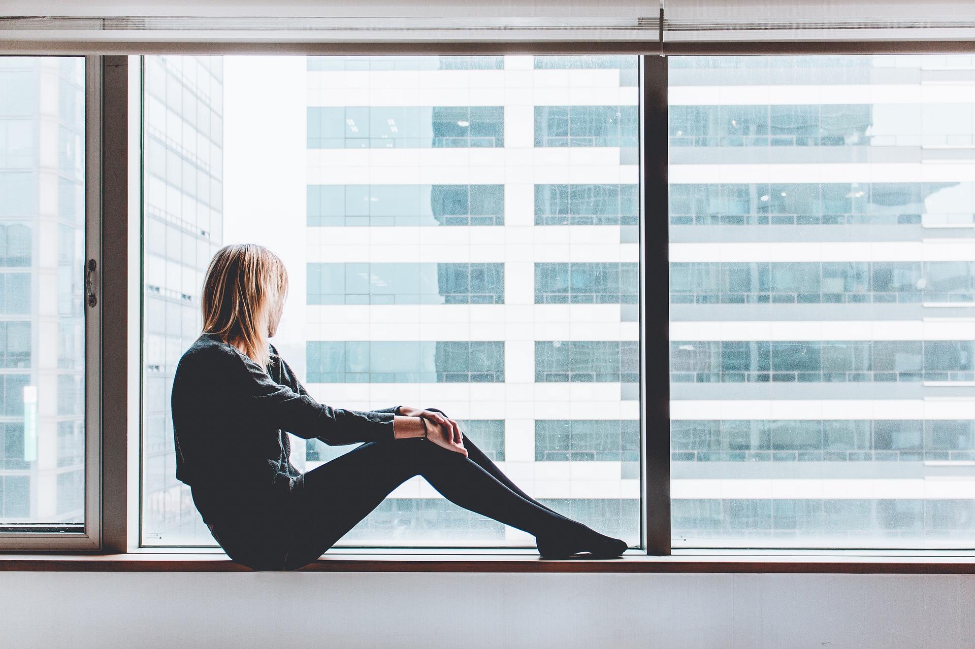 Female sat near window looking out