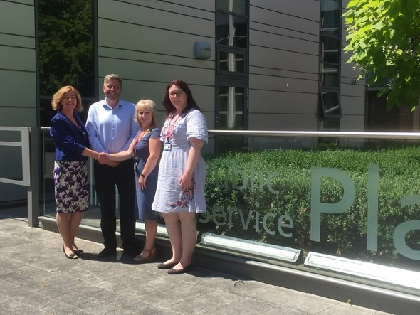 Victim Support Staff shaking hands with management of Havant Plaza