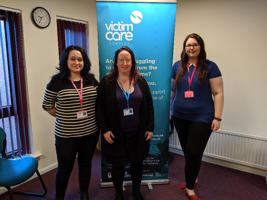 Domestic abuse team stood in front of Victim Care Service Benner
